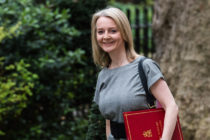 Liz Truss holding a red portfolio box
