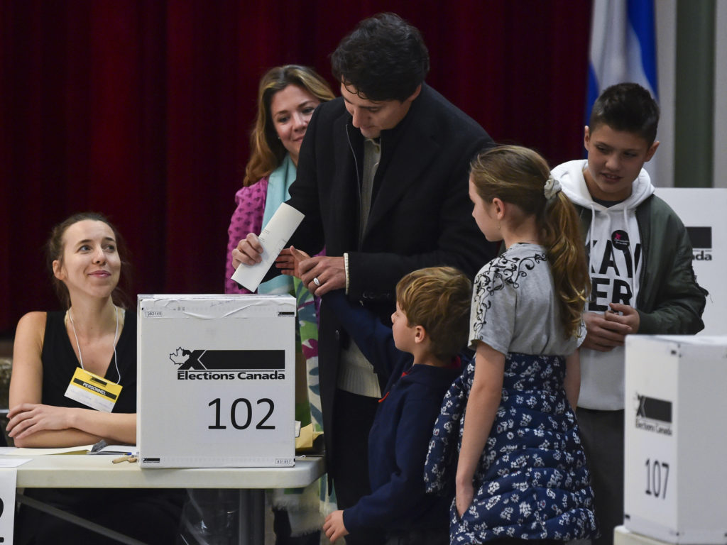 Canadian Prime Minister Justin Trudeau is surrounded by his family as he casts his vote on election day. (Minas Panagiotakis/Getty Images)