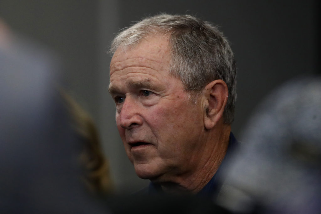 Former President George W. Bush attends the NFL game between the Dallas Cowboys and the Green Bay Packers. (Ronald Martinez/Getty Images)