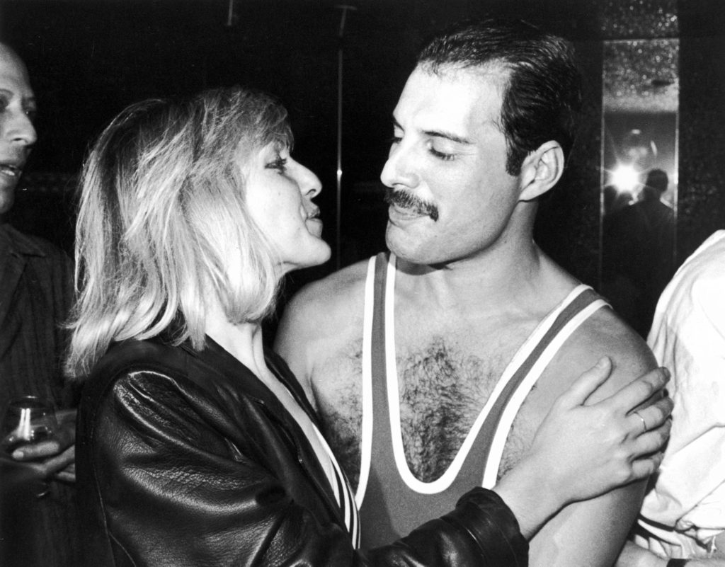 Freddie Mercury with Mary Austin, during Mercury's 38th birthday party at the Xenon nightclub, London, UK, September 1984. (Dave Hogan/Getty Images)
