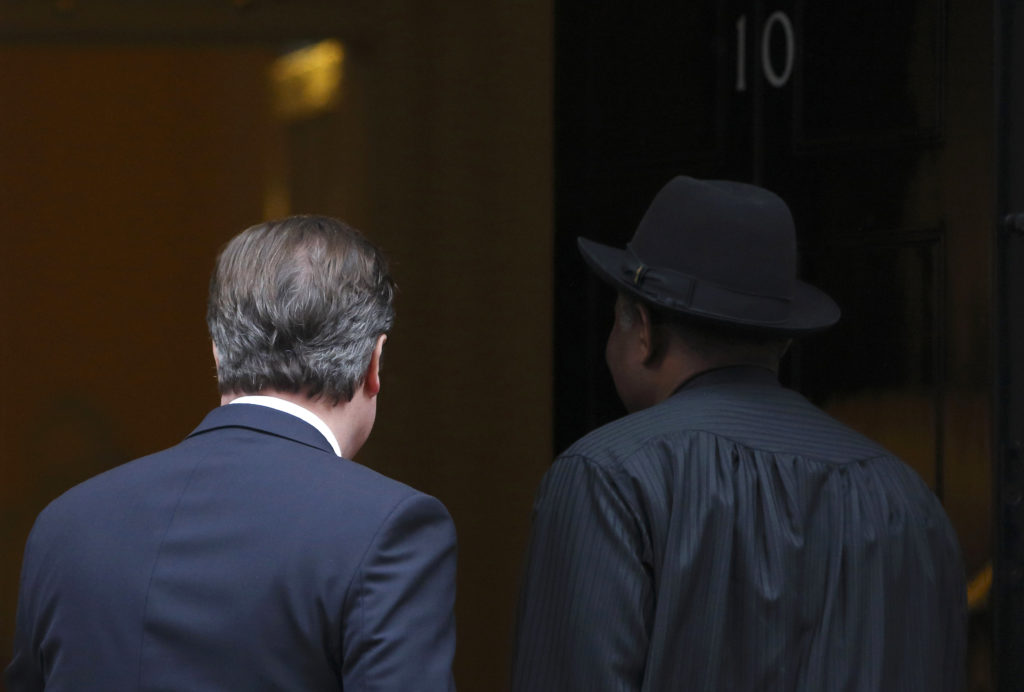 Former Nigerian president Goodluck Jonathan (R) is welcomed to Downing Street by then British prime minister David Cameron in 2013. (Oli Scarff/Getty Images)