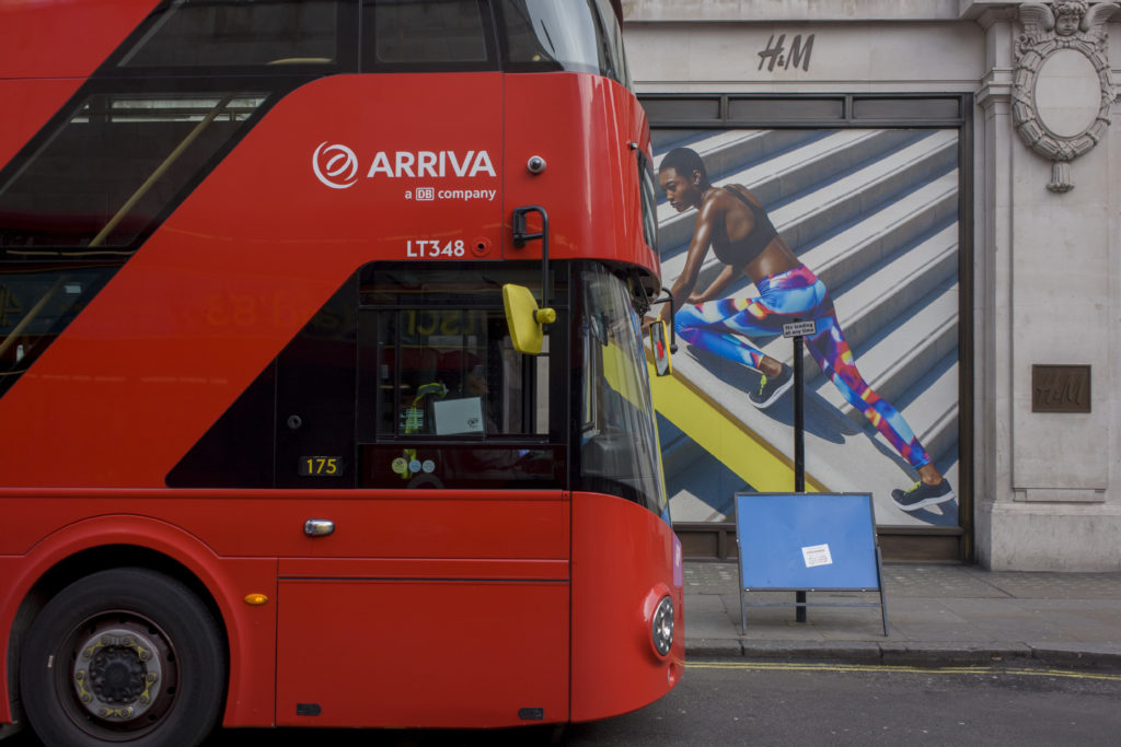 An Arriva bus pulls up in front of a H&M store in London. (In Pictures Ltd./Corbis via Getty Images)