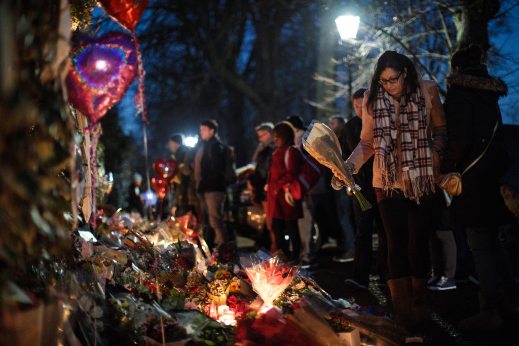 A woman lays flowers among tributes outside the home of pop music icon George Michael in The Grove, Highgate on December 28, 2016 in London, England. (Photo by Jack Taylor/Getty Images)