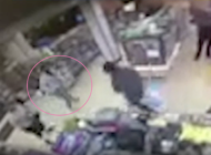 In CCTV footage, the man (highlight by a pink circle) is beelined by two men in a 7-Eleven. (Screen capture via NBC10)