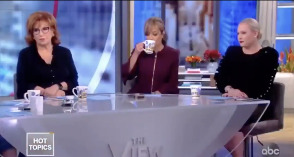 Columnist Sunny Hostin (C) was every viewer as she cooly sipped her tea during the fiery exchange unfolding in front of her. (Screen capture via Twitter)