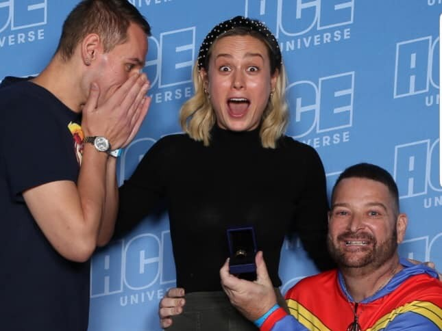 A gay couple got engaged right in front of Brie Larson and her reaction should be framed and hung in the Louvre