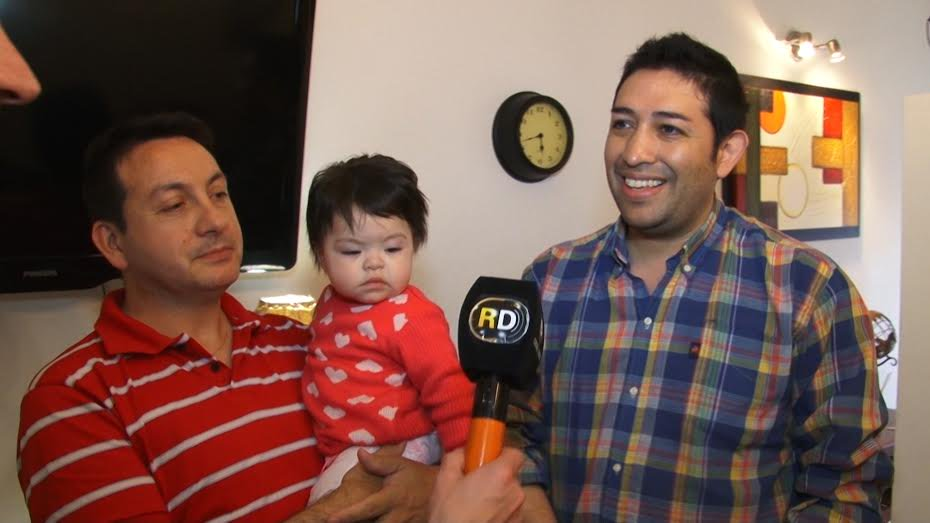 Gay couple adopts HIV-positive baby after she was rejected by 10 families