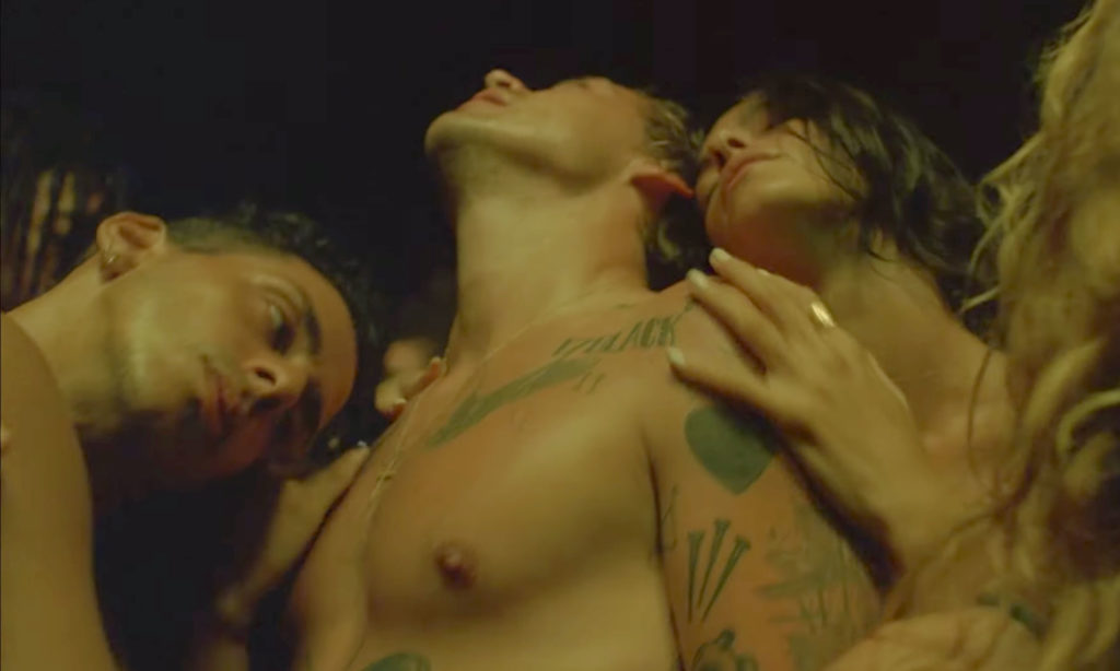 Harry Styles topless with a man and woman