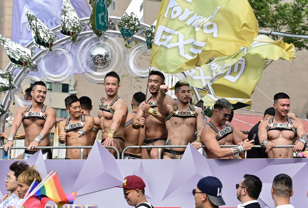 Topless men wearing briefs and harnesses on a float during Taiwan Pride 2019