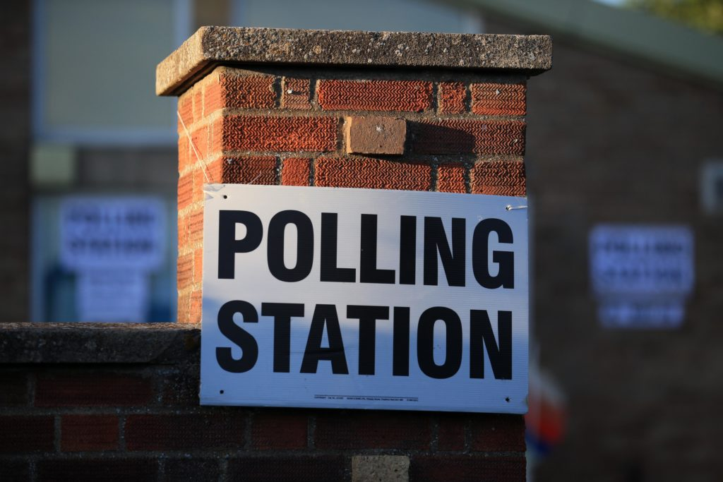 Brits will brave bitterly cold temperatures in two weeks to vote. (LINDSEY PARNABY/AFP via Getty Images)