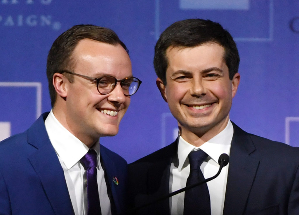Chasten Glezman Buttigieg greets his husband, South Bend, Indiana Mayor Pete Buttigieg