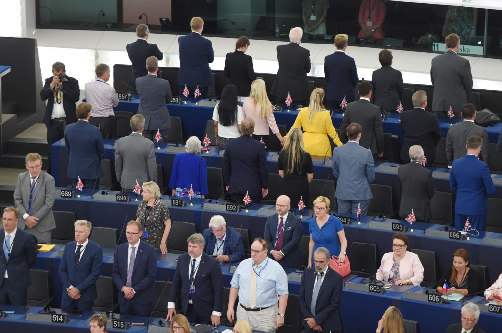 The British MEP Brexit Party bloc turn their backs during the European anthem. (FREDERICK FLORIN/AFP via Getty Images)