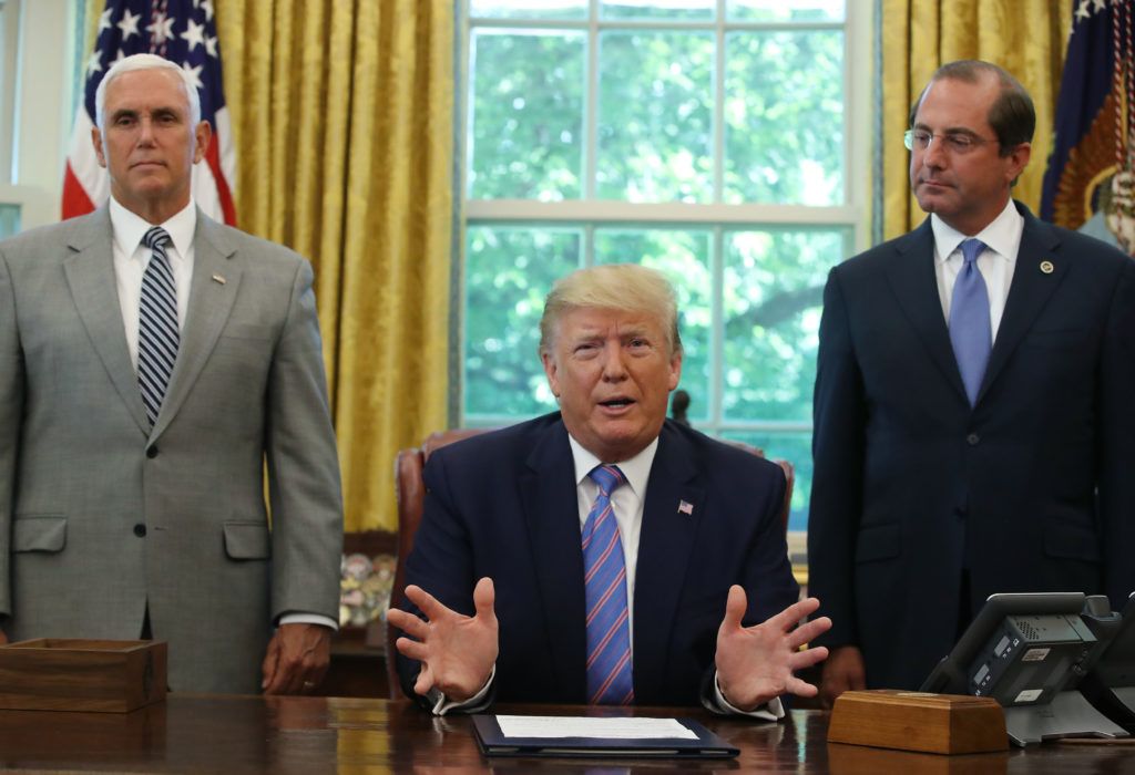 Trump adoption rule: President Donald Trump with Vice President Mike Pence and Health and Human Services (HHS) Secretary Alex Azar
