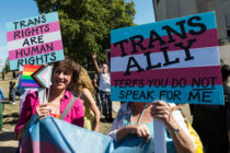 Young non-binary person calls for cis people to stand up for trans rights
