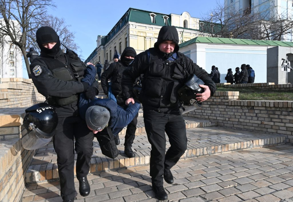 Policemen detain an individual who was protesting against the Transgender Day of Remembrance event in Kyiv. (Genya SAVILOV / AFP) (Photo by GENYA SAVILOV/AFP via Getty Images)