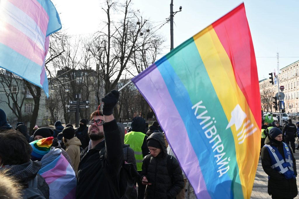 A man holds an Rainbow flag during an anti-transphobia rally in Kiev on November 23, 2019.. (GENYA SAVILOV/AFP via Getty Images)