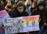 Participants hold drawings reading 'Transphobia kills, humanity saves' during an anti-transphobia rally in Kyiv, on November 23, 2019. (GENYA SAVILOV/AFP via Getty Images)