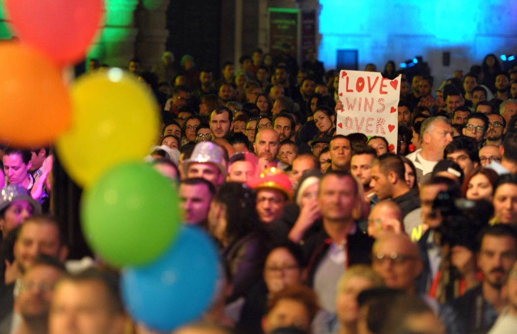 People gather to celebrate in Saint George's Square after the Maltese parliament approved a civil unions bill in Valletta on April 14, 2014. (Matthew Mirabelli/AFP via Getty Images)