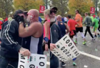A video of a man passionately kissing someone during the New York City marathon has gone viral. (Screen captures via Twitter)