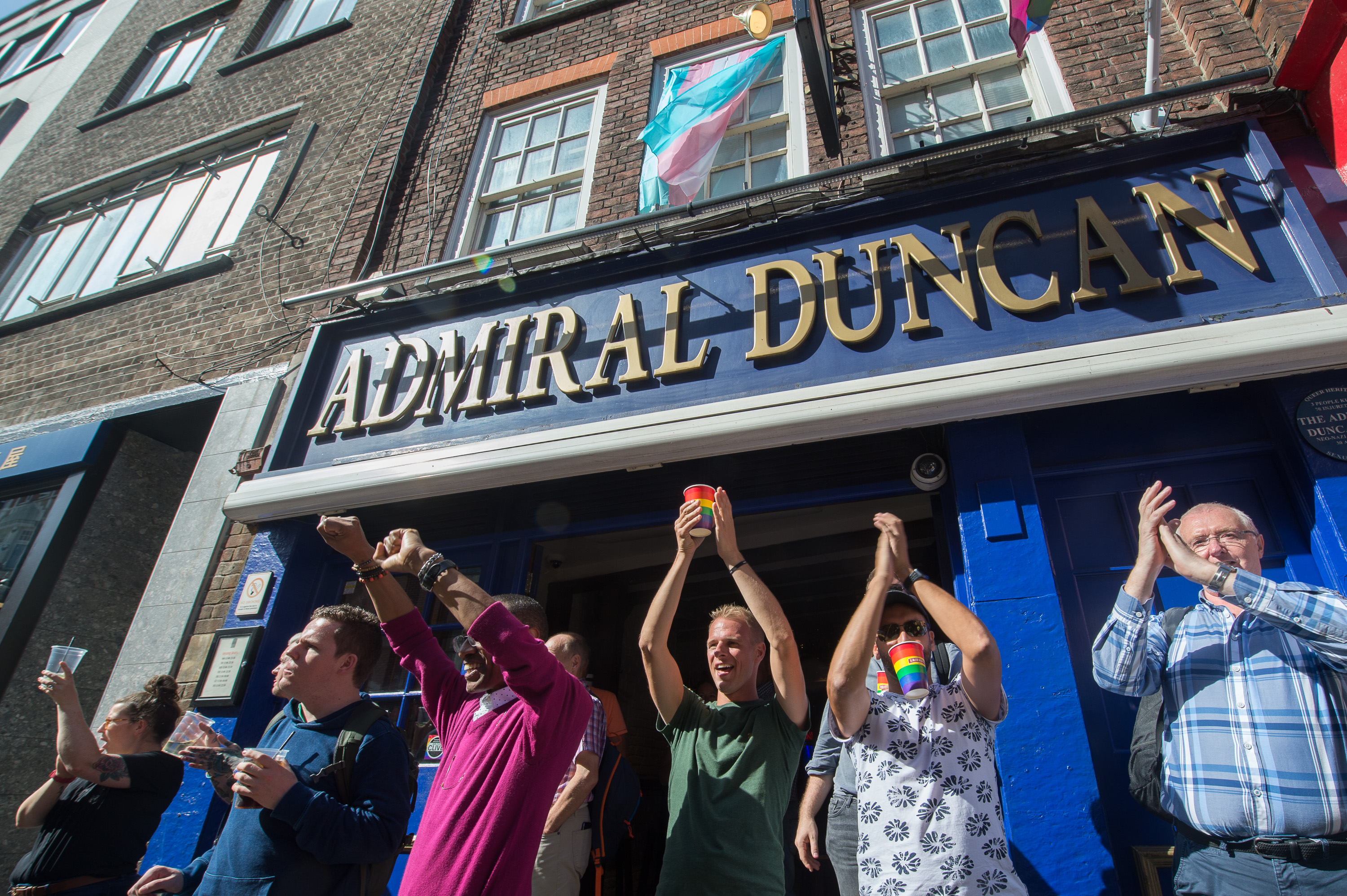 Customers at the Admiral Duncan applaud the 2019 Trans Pride parade.