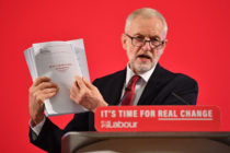 Jeremy Corbyn holding a dossier of UK-US talks