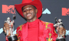 Lil Nas X holding two MTV Awards