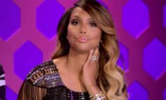Tamar Braxton behind the judging table on RuPaul's Drag Race.
