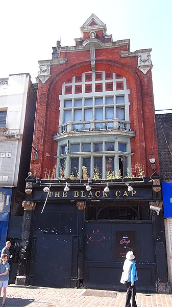 The front façade of the Black Cap, boarded up in 2018. (Wikimedia Commons)