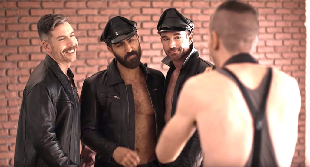 Three queer men in leather