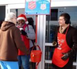 An old photograph of Pete Buttigieg ringing the signature bells of the Salvation Army has incited criticism online. (Twitter)