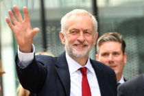 Labour Party leader Jeremy Corbyn waves as he arrives during the Labour Party conference on September 26, 2018. (Anthony Devlin/Getty Images)