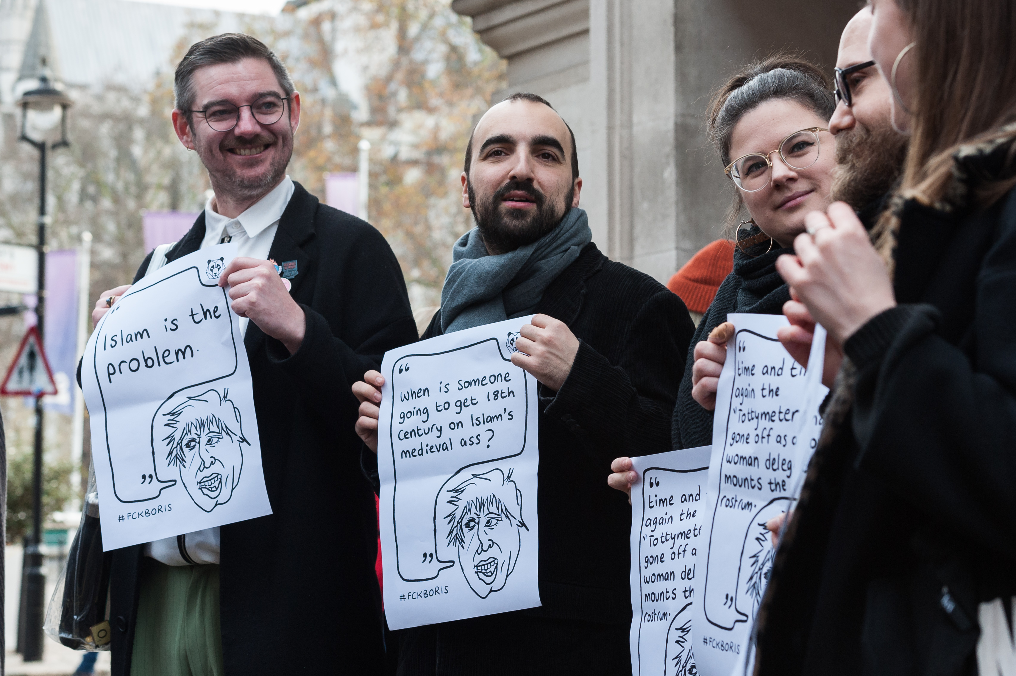 Protesters held signs quoting actual things Boris Johnson has said and written