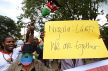 Kenyan gay and lesbian organisations demonstrate outside the Nigerian High Commission in Nairobi, one holding a yellow sign that reads: 'Nigeria: LGBTI, We are together'
