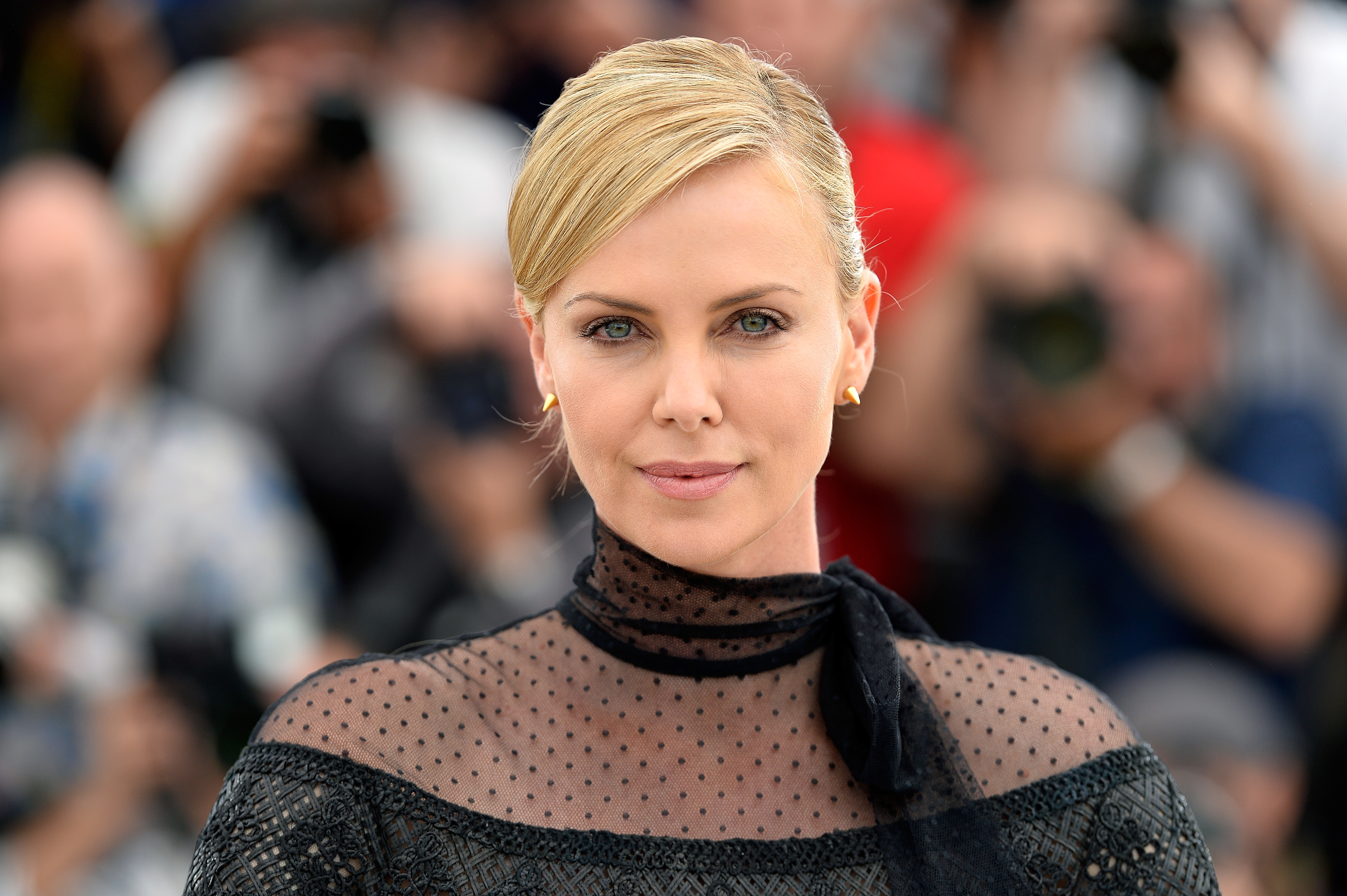 "Charlize Theron attends a photocall for ""Mad Max: Fury Road"" during the 68th annual Cannes Film Festival on May 14, 2015 in Cannes, France."