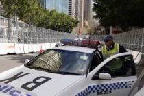 SYDNEY, AUSTRALIA - SEPTEMBER 06: A policeman gets into a police car, parked between security fences, on September 6, 2007 in Sydney, Australia. (Amos Aikman/Getty Images)
