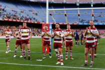 Wigan Warriors players acknowledge their fans at the end of the Betfred Super League between Cataland Dragons and Wigan Warriors match at Camp Nou on May 18, 2019