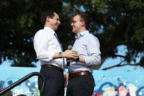 Democratic presidential candidate and South Bend, Indiana Mayor Pete Buttigieg (L) is introduced by his husband, Chasten Glezman Buttigie. (Joe Raedle/Getty Images)