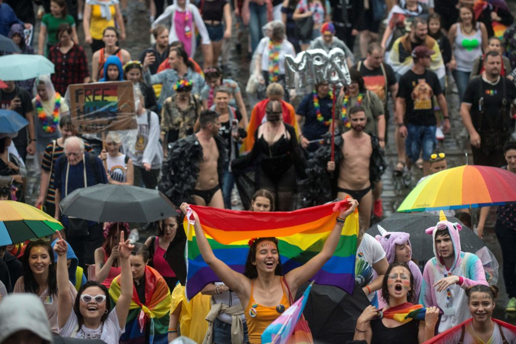 People hold placards and rainbow flags during the ninth LGBT+ Pride event in the Czech capital Prague on August 10, 2019. (MICHAL CIZEK/AFP via Getty Images)
