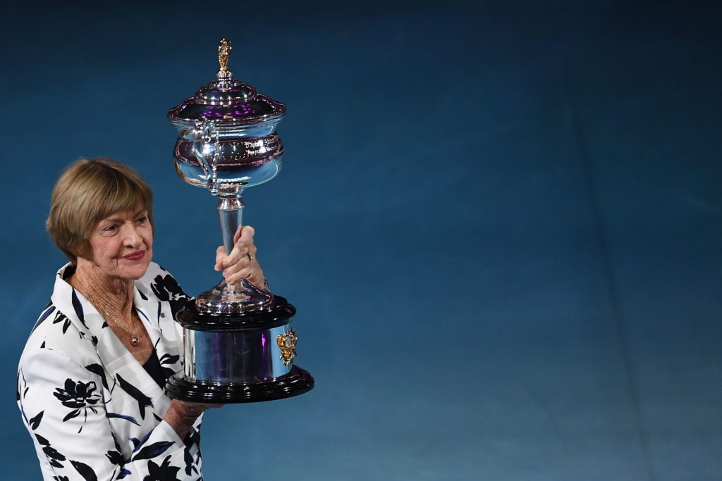 Former Australian tennis player Margaret Court poses with a replica of the trophy to commemorate 50 years of her Australian grand slam win