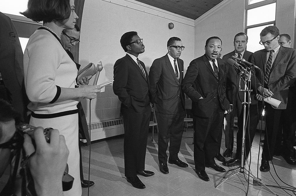 American Civil Rights leader Dr. Martin Luther King Jr speaks to journalists at a 1968 press conference, with Bayard Rustin center left