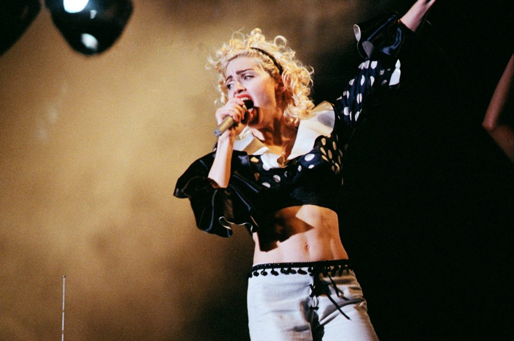 Madonna performs on stage on her Blonde Ambition tour at Wembley Stadium, on July 20th, 1990 in London, England. (Pete Still/Redferns)