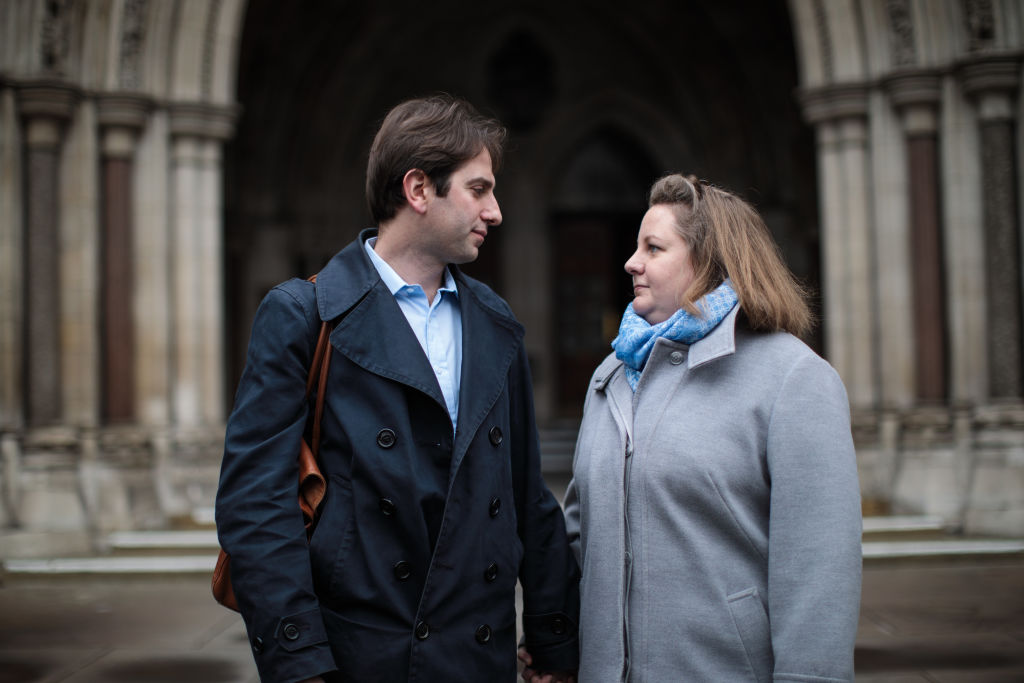 Charles Keidan and Rebecca Steinfeld look into each other's eyes as they pose outside the Royal Courts of Justice, Strand on February 21, 2017 in London, England.