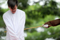 One of two Indonesian men is publicly caned for having sex, in a first for the Muslim-majority country where there are concerns over mounting hostility towards the small gay community, in Banda Aceh on May 23, 2017. (CHAIDEER MAHYUDDIN/AFP via Getty Images)