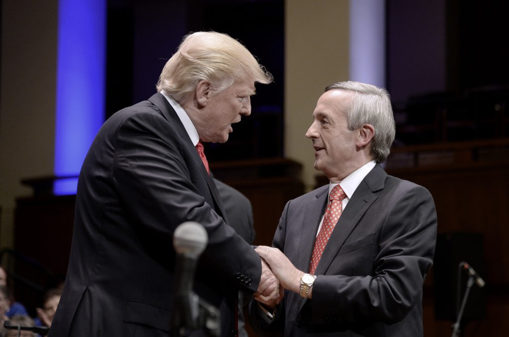 US president Donald Trump is greeting by pastor Robert Jeffress