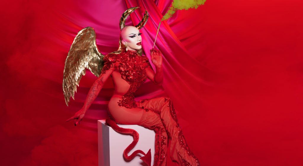 Sasha Velour dressed as a devil with gold wings