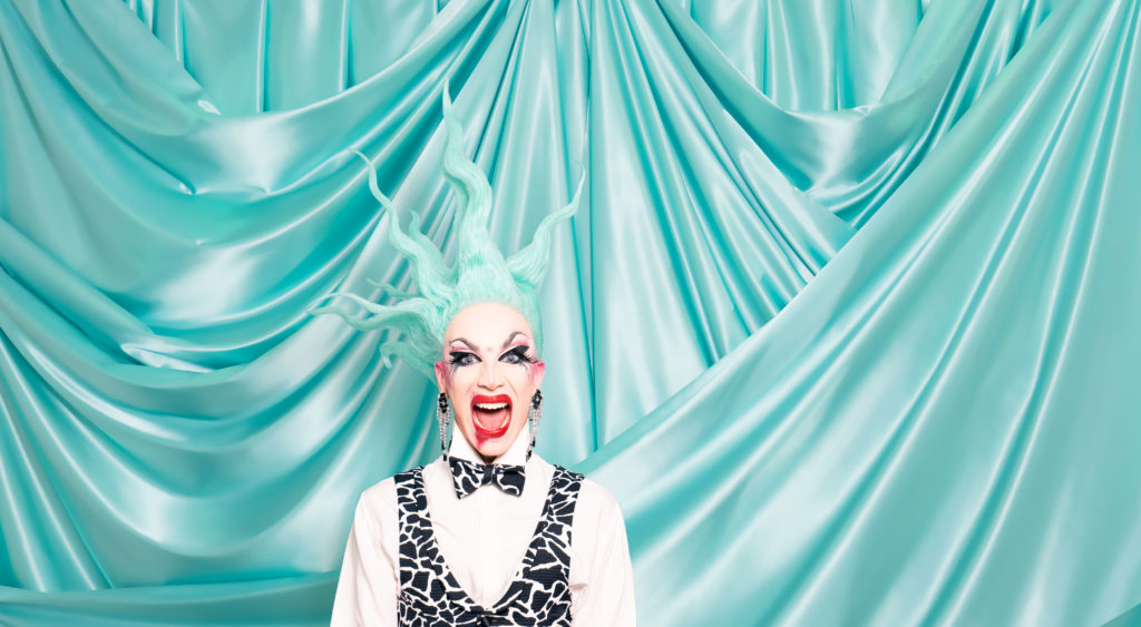 Sasha Velour in a spiky turquoise wig