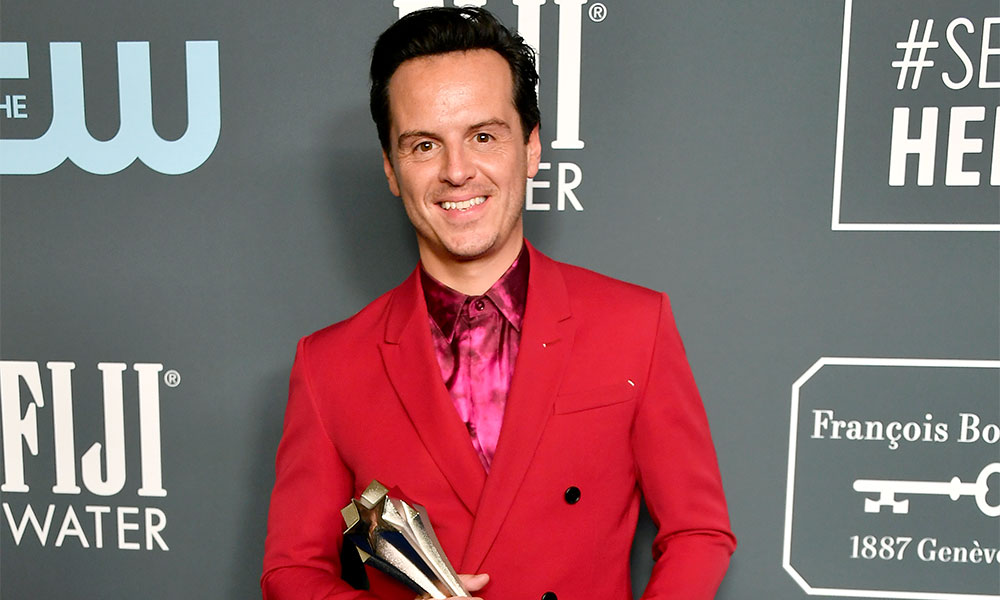 Andrew Scott in a red suit with a fuschia shirt