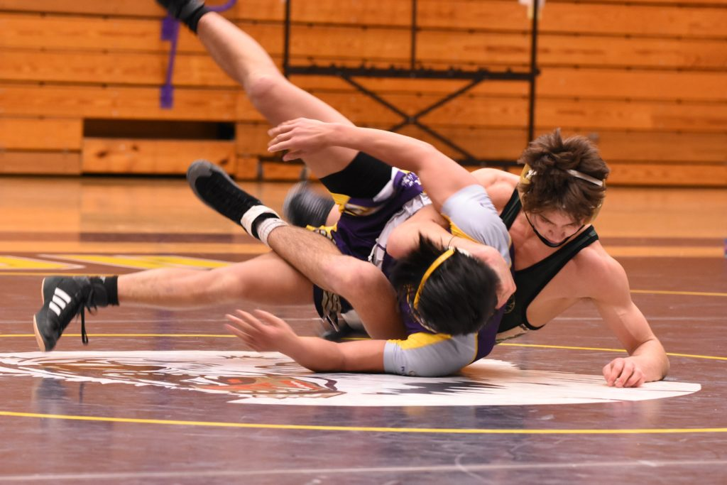 A priest was caught taking photos in a high school gym during a wrestling tournament without consent or knowledge. (Stock photo via UnSplash)