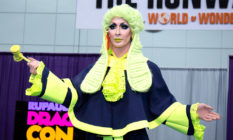 Detox in a green judges wig, holding a gavel