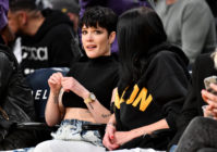 Halsey at a basketball game, looking worried